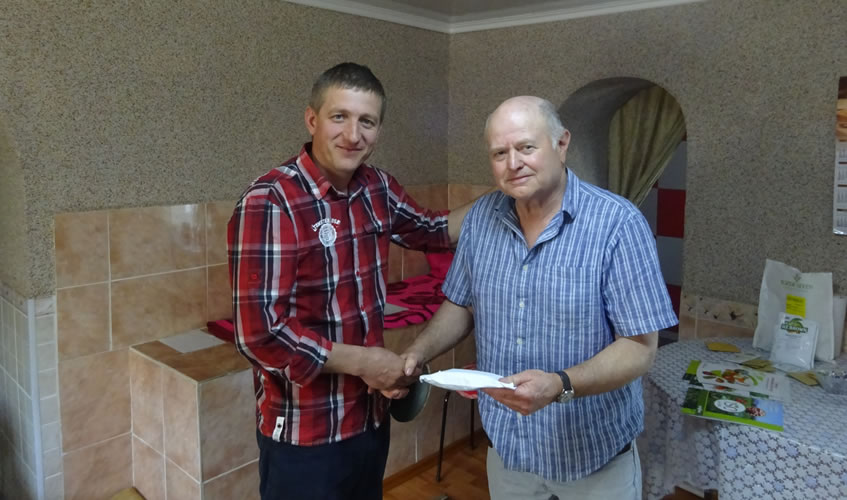 Mike handing over monies for the Hirtop Meal-Deal to Oleg.