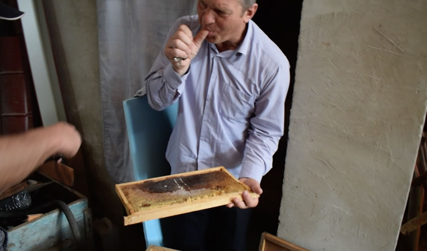 Pastor Valerie tasting his superb honey.